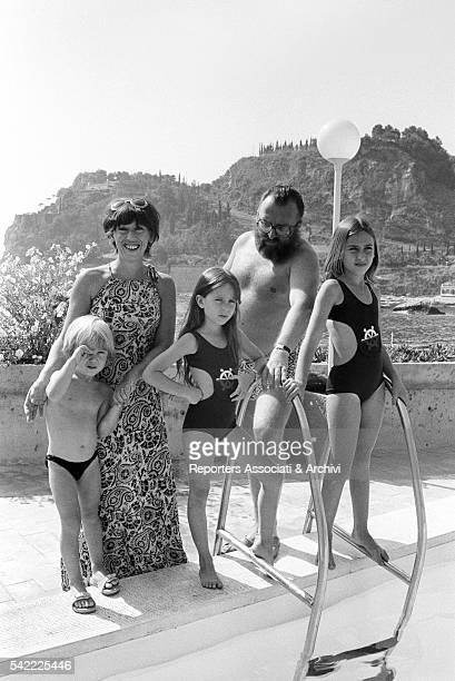 Italian director Sergio Leone in a swimming pool with his wife Carla and his children Francesca Raffaella and Andrea 1972