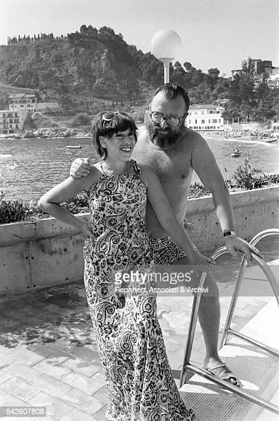 Italian director Sergio Leone in a swimming pool with his wife Carla 1972