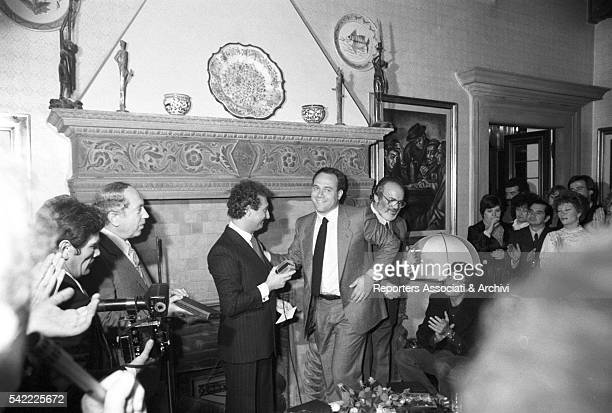 Italian director Sergio Leone receiving an award at the Morazzani salon Next to him are TV host Nando Pucci Negri and Italian actors Mario Brega...