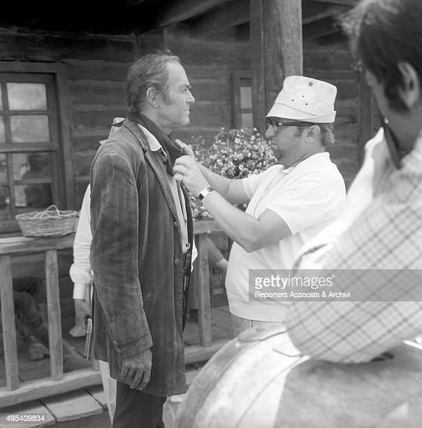Italian director Sergio Leone tidying the American actor Henry Fonda's scarf on the set of the film Once Upon a Time in the West. 1968