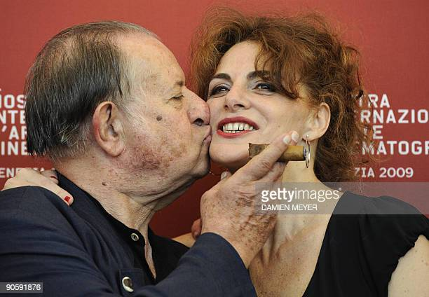 "Italian director Tinto Brass and actress Caterina Varzi pose during the photocall of ""Hotel Courbet"" at the Venice film festival on September 11,..."