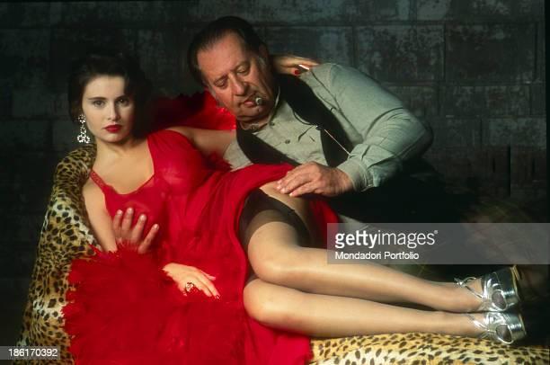 Italian director Tinto Brass touching Italian actress Debora Caprioglio's leg on the set of the film Paprika, Life in a Brothel. Rome, 1990.