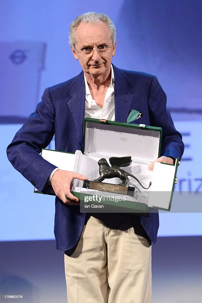 Italian director Uberto Pasolini poses with his Orizzonti award for best director for his movie 'Still Life' on stage during the Closing Ceremony at the 70th Venice International Film Festival at the Palazzo del Casino on September 7, 2013 in Venice, Italy.