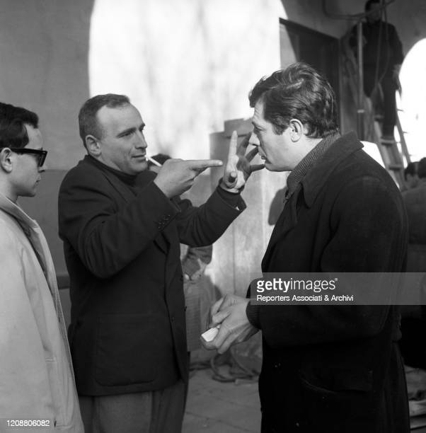 """Italian director Valerio Zurlini gesticulating while talking to Italian actor Marcello Mastroianni during a break on the set of the film """"Family..."""