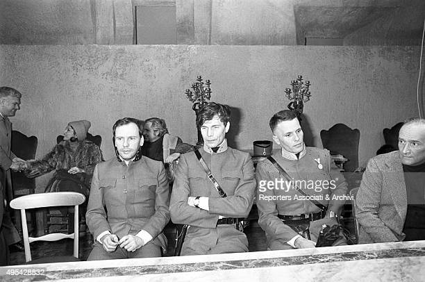 Italian director Valerio Zurlini, Italian actor Giuliano Gemma and French actors Laurent Terzieff and Jean-Louis Trintignant sitting on the set of...