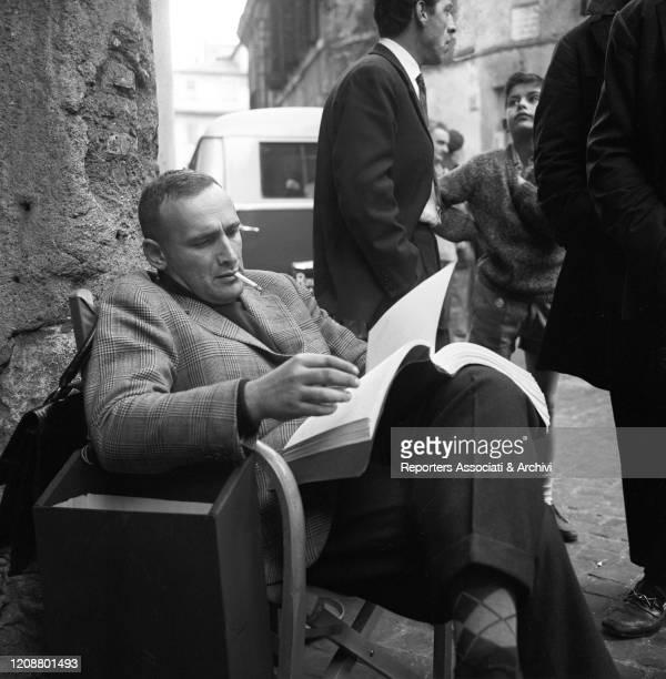 "Italian director Valerio Zurlini reading the script during a break on the set of the film ""Family Diary"". 1962"