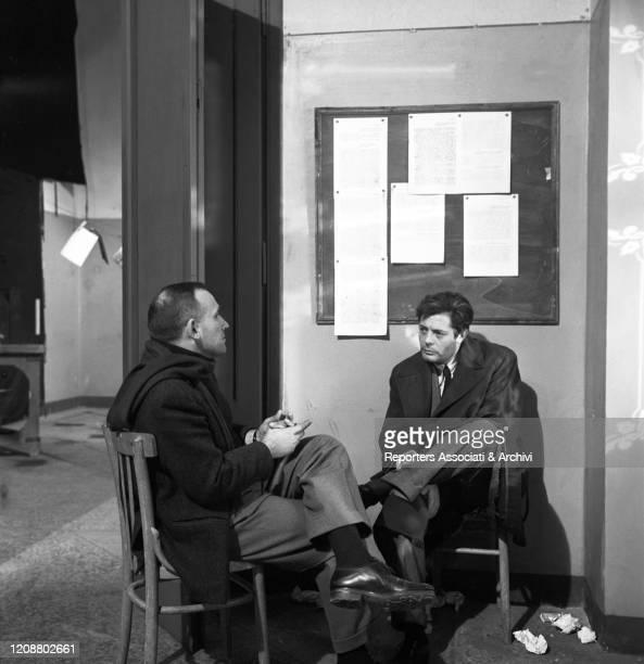 "Italian director Valerio Zurlini talking to Italian actor Marcello Mastroianni during a break on the set of the film ""Family Diary"". 1962"