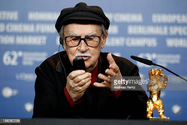 Italian director Vittorio Taviani uses his cell phone after receiving the Golden Bear prize awarded for their film 'Caesar Must Die' at the Award...