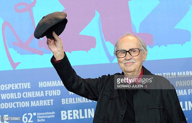Italian director Vittorio Taviani waves during a press conference for the film Ceasar Must Die on February 11 2012 in Berlin The 62nd Berlinale the...
