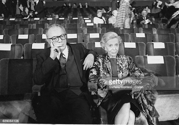 Italian director's Federico Fellini and actress wife Giulietta Masina sitting in the stalls waiting for the screening of the film The Voice of the...