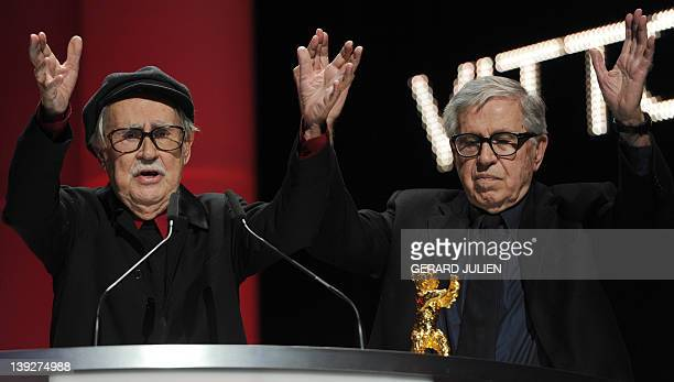 Italian directors Paolo and VittorioTaviani celebrate after being awarded the Golden Bear prize for their film Caesar Must Die on February 18 2012 in...