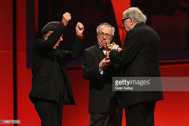 Italian directors Vittorio and Paolo Taviani celebrate after receiving the Golden Bear prize awarded for their film 'Caesar Must Die' with Dieter...