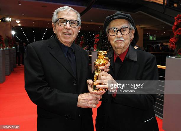 Italian directors Vittorio and Paolo Taviani celebrate after receiving the Golden Bear prize awarded for their film 'Caesar Must Die' after the...