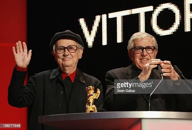 Italian directors Vittorio and Paolo Taviani celebrate after receiving the Golden Bear prize awarded for their film 'Caesar Must Die' the Closing...