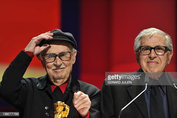 Italian directors Vittorio and Paolo Taviani celebrate after receiving the Golden Bear prize awarded for their film Caesar Must Die on February 18...