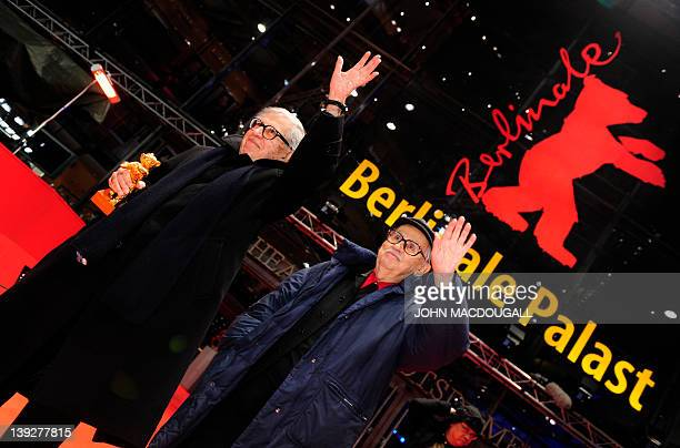 Italian directors Vittorio and Paolo Taviani celebrate with the Golden Bear prize awarded for their film Caesar Must Die on February 18 2012 in...