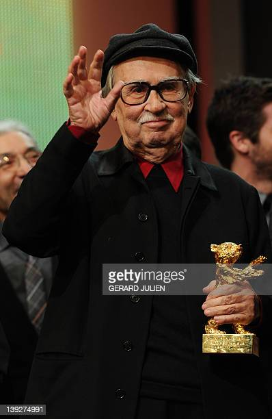 Italian directors Vittorio celebrates after receiving the Golden Bear prize awarded for their film Caesar Must Die on February 18 2012 in Berlin...