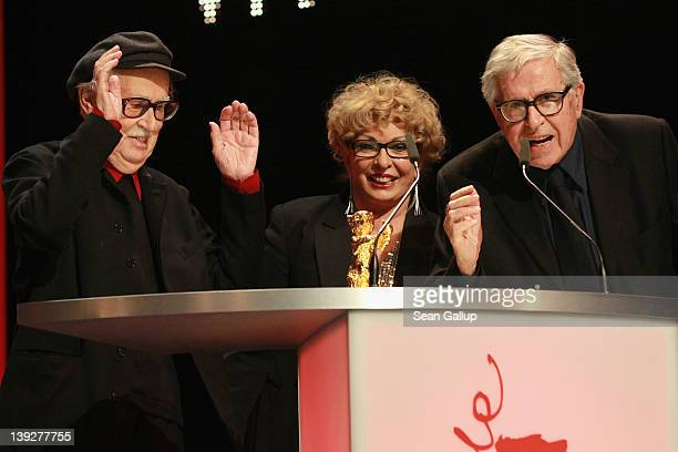 Italian directors Vittorio producer Grazia Volpi and Paolo Taviani celebrate after receiving the Golden Bear prize awarded for their film 'Caesar...