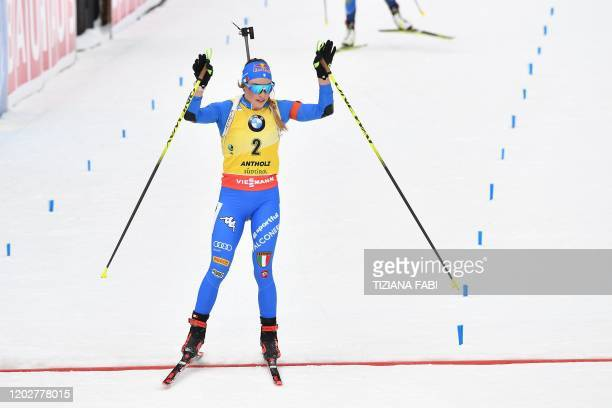 Italian Dorothea Wierer crosses the finich line to place second of the Women 125 km Mass Start Competition at the IBU Biathlon World Cup in...