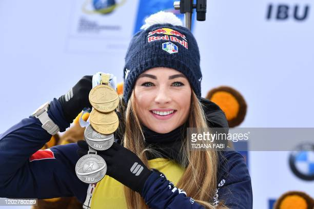 Italian Dorothea Wierer poses with all the medals she won in the world cup after placing second of the Women 125 km Mass Start Competition at the IBU...