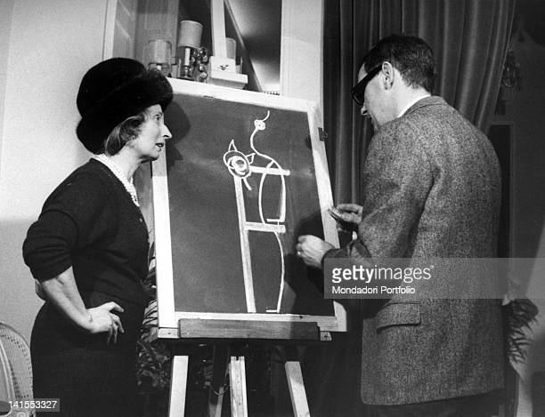 Italian dressmaker and fashion designer Biki's soninlaw drawing a pattern on a blackboard Milan 1963