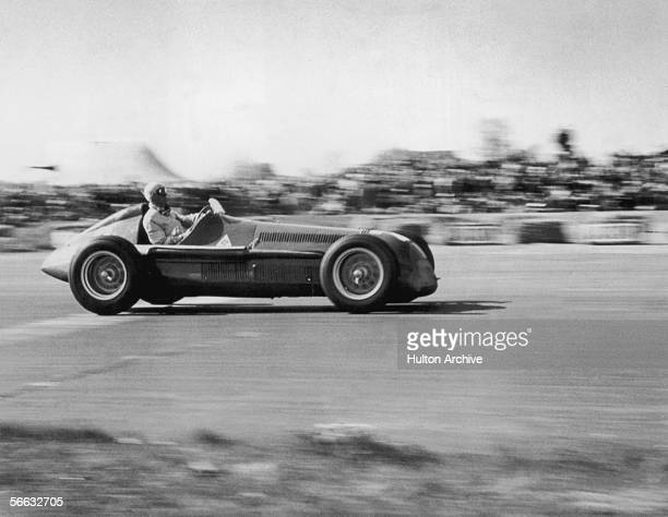 Italian driver Giuseppe Farina on his way to winning the European Grand Prix at Silverstone in his Alfa Romeo Tipo 158, 13th May 1950.