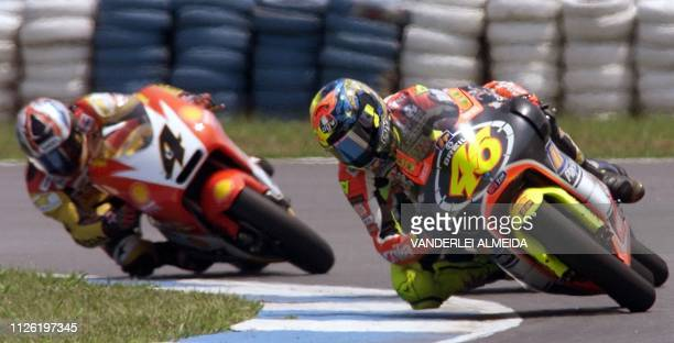 Italian driver Valentino Rossi of team Aprilia takes a curve during the 250cc category race 24 October 1999 at the Brazilian Grand Prix in Rio de...