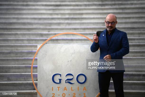 Italian Ecological Transition Minister Roberto Cingolani poses at Palazzo Reale in Naples on July 22 for the climate and energy G20 meeting.