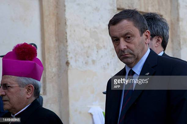Italian education minister Francesco Profumo arrives at the church for the funeral service of Melissa Bassi on May 21, 2012 in Mesagne. Italian...