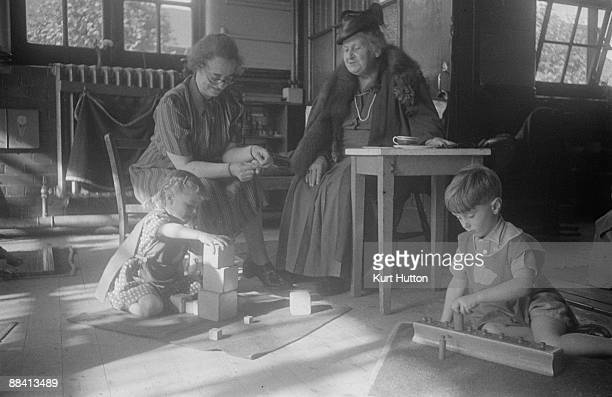 Italian educationist and founder of the Montessori Schools Maria Montessori watching pupils in class at a school in Acton London 2nd November 1946...