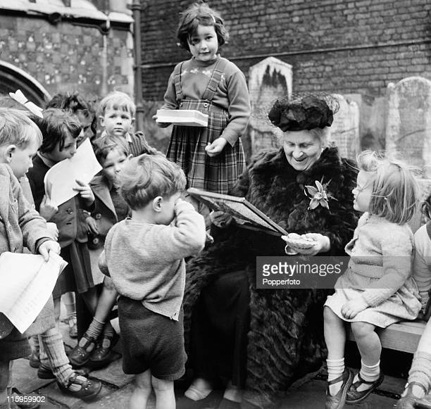 Italian educator Maria Montessori with young children at her school in Smithfield London circa 1951