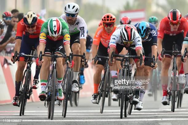 Italian Elia Viviani of DeceuninckQuickStep team crosses the finish line ahead of Colombian Fernando Gaviria of UAE Team during the fifth stage of...