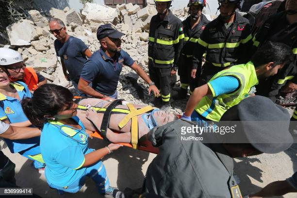 Italian emergency workers evacuate on a stretcher a boy who was was trapped by rubble, in Casamicciola Terme, on the Italian island of Ischia, on...