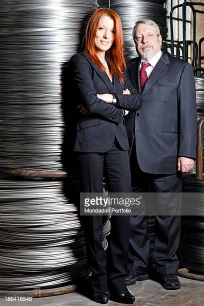 Italian entrepreneur and politician Michela Vittoria Brambilla posing in front of some steel wires in stack beside her father and president of...