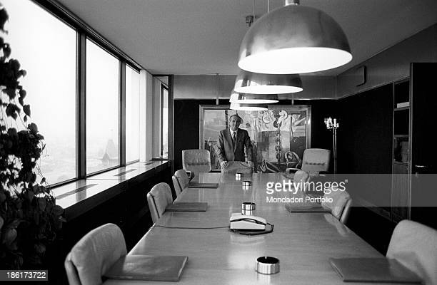 Italian entrepreneur and president of Confindustria Luigi Lucchini posing leaning on a chair in the meeting room of his company Behind him a painting...
