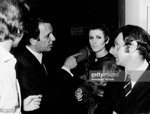 Italian entrepreneur and theatre manager Sergio Bernardini pointing British singer Julie Driscoll Italian singer and actor Ray Martino watches them...