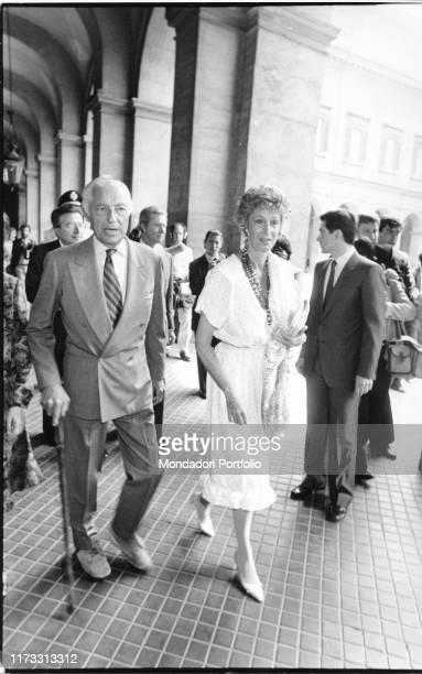 Italian entrepreneur Gianni Agnelli walking with his wife Marella Agnelli 1990s