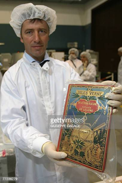Italian ESA astronaut Roberto Vittorio holds one copy of Jules Verne's book 'De la Terre a la Lune' ready to be packed to go on the space with the...