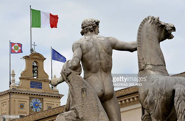 Italian European and Italy's presidential flags fly on the roof of the Quirinale Palace the presidential official residence on April 20 2013 in Rome...