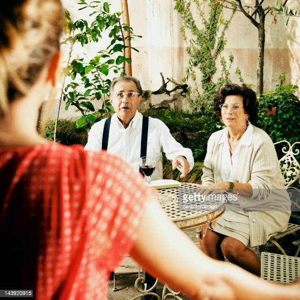Italian family: woman visiting parents