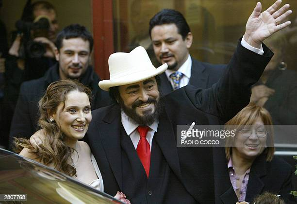 Italian famous tenor Luciano Pavarotti and Nicoletta Mantovani smiles after their wedding ceremony in Modena's main theatre 13 December 2003...