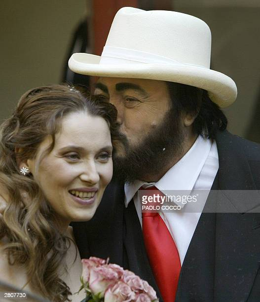 Italian famous tenor Luciano Pavarotti kisses Nicoletta Mantovani after their wedding ceremony in Modena's main theatre 13 December 2003 Pavarotti's...