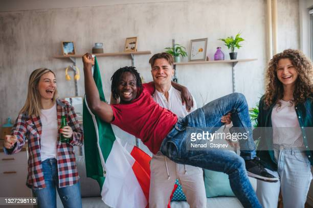 italian fans are watching the european championship matches - international match stock pictures, royalty-free photos & images