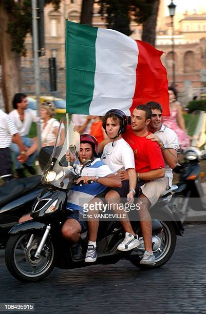 Italian fans celebrate on Piazza Venezia in Rome Italy's win over Australia in their second round World Cup 2006 soccer match in Rome Italy on June...