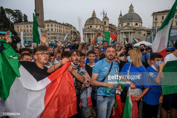 Italian fans celebrate the victory of Italy as they watch on giant screens at the fan zone the UEFA Euro 2020 Championship Group A match between...