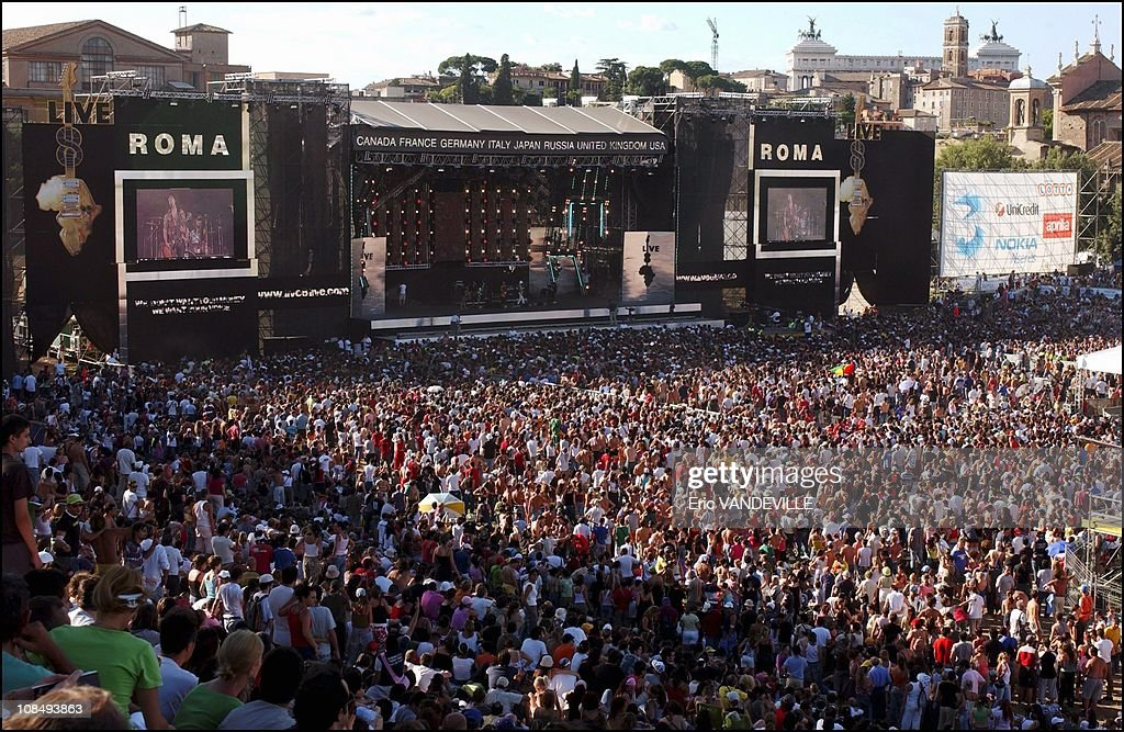 https://media.gettyimages.com/photos/italian-fans-cheer-at-the-live-8-italy-concert-inside-romes-ancient-picture-id108493863