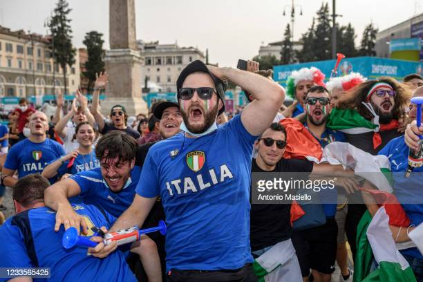Italian fans react as they watch on giant screens at the fan zone the UEFA Euro 2020 Championship Group A match between Italy and Wales played at the...