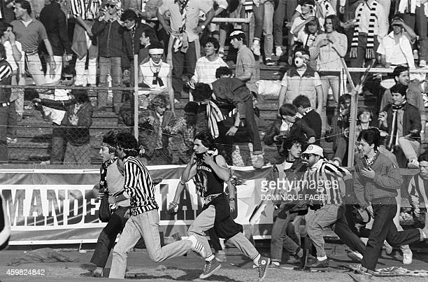 Italian fans run on May 29 1985 in Heysel stadium in Brussels as violence has broken out one hour before the European Champion Clubs final between...