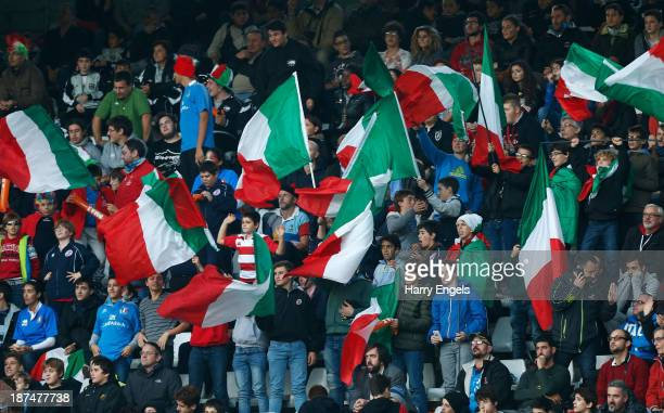 Italian fans wave flags in the crowd during the international match between Italy and Australia at the Stadio Olimpico on November 9 2013 in Turin...