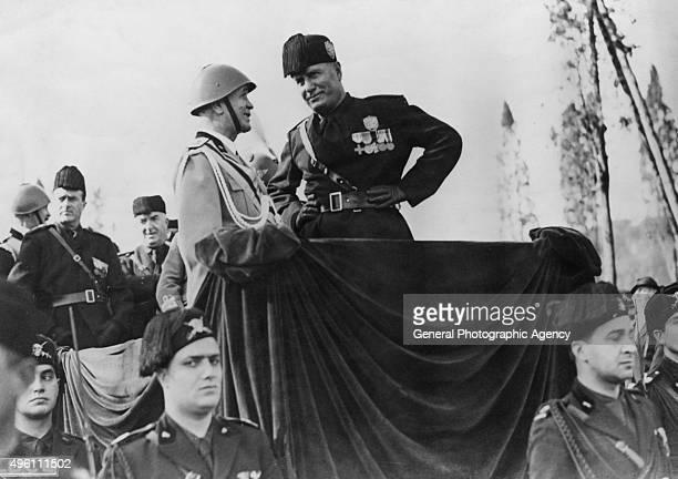 Italian fascist dictator Benito Mussolini at a march past of athletes in the Via Del Circo Massimo Rome 28th October 1934
